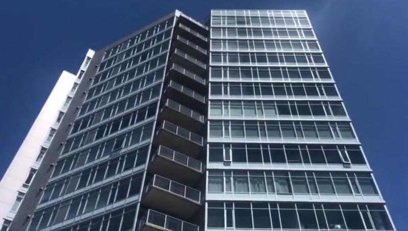 Photo of building where a woman fell 16 stories down a bin chute.