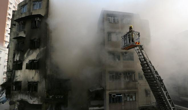 Firefighters battle the blaze in the aftermath of the garage explosion in April 2015. Photo: SCMP