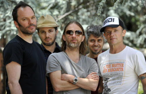 This May 22, 2013 photo shows members of Atoms For Peace , from left, Nigel Godrich, Joey Waronker, Thom Yorke, Mauro Refosco and Flea posing for a portrait in Los Angeles. The band's 27-date tour begins in July in Europe and will reach the US in September before ending in Japan. (Photo by Chris Pizzello/Invision/AP)