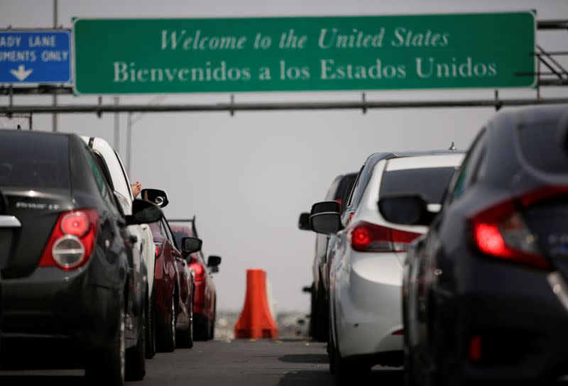 Long delays at U.S.-Mexico border crossings after new travel restrictions