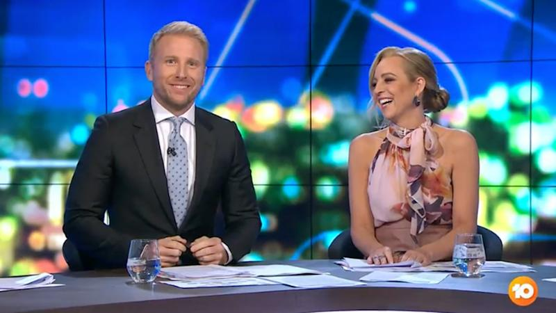A photo of hosts Carrie Bickmore and Hamish Macdonald on set of The Project.