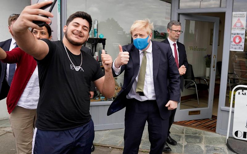 Mr Johnson met with people and practiced social distancing during the visit - @BorisJohnson / Twitter