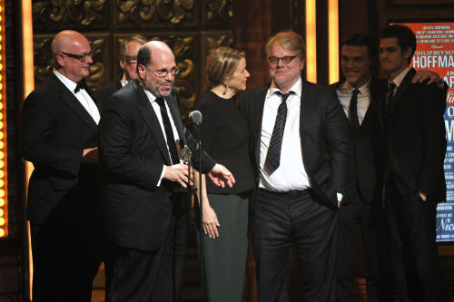 "Producer Scott Rudin, second left, and the cast of ""Arthur Miller's Death of a Salesman,"" accept the award for best revival of a play at the 66th Annual Tony Awards on Sunday June 10, 2012, in New York. (Photo by Charles Sykes /Invision/AP)"