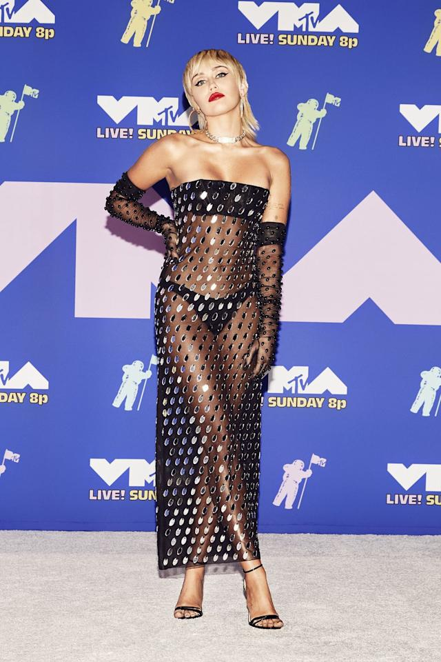 <p>Cyrus wears a sheer and shimmering dress by Mugler. </p>