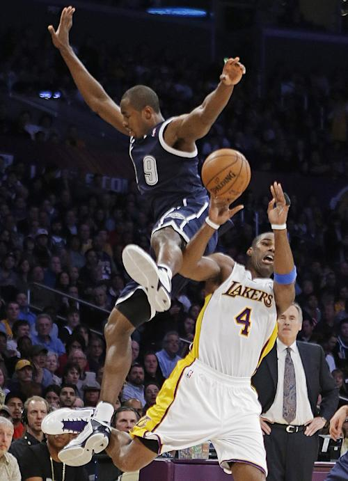 Oklahoma City Thunder forward Serge Ibaka (0), of the Republic of Congo, and Los Angeles Lakers forward Antawn Jamison (4) collide while going for possession of the ball in the first half of an NBA basketball game in Los Angeles, Sunday, Jan. 27, 2013. (AP Photo/Reed Saxon)