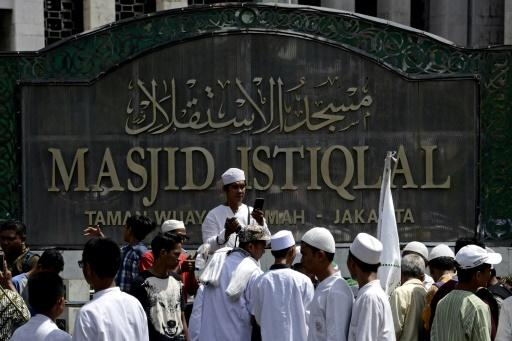 A group of Muslim men gather at the Istiqlal mosque in Jakarta, Indonesia, the world's biggest Muslim majority country, where being an atheist is taboo
