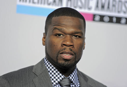 FILE - In this Nov. 18, 2012, file photo, rapper 50 Cent arrives at the 40th Anniversary American Music Awards in Los Angeles. After battling with his major label for years, 50 Cent has decided to become an independent artist. The rapper announced Thursday, Feb. 20, 2014, he's leaving his longtime record label, Universal Music Group's Interscope Records, and Eminem's imprint, Shady/Aftermath. The Grammy winner and his G-Unit Records have signed a distribution agreement with Caroline, the independent label at Capital Music Group. Capitol is one of the many labels part of Universal Music Group. (AP Photo/Jordan Strauss/Invision/AP)