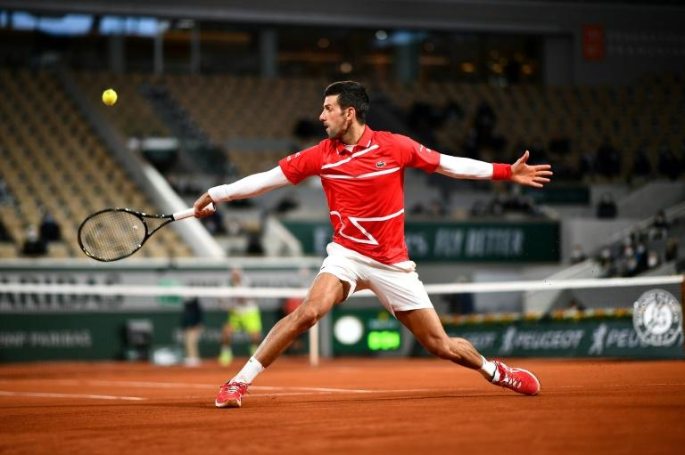 Djokovic keeps French Open title bid on track as Kenin survives