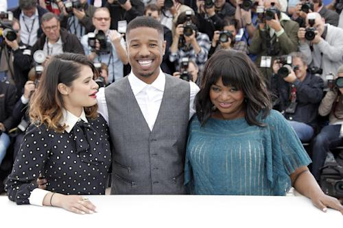 "FOR STORY FRANCE CANNES MICHAEL B JORDAN - A photo call for the film Fruitvale Station, with actors from left, Melonie Diaz, Michael B. Jordan and Octavia Spencer as they pose for photographers during at the 66th international film festival, in Cannes, southern France, Thursday, May 16, 2013. ""Fruitvale Station"" has received rave reviews at Cannes, and its power owes much to Jordan's performance, according to reviewers. (AP Photo/Francois Mori)"