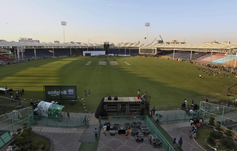 In this Monday, Feb. 17, 2020, photo, workers prepare stage for opening ceremony of Pakistan Super League at National stadium in Karachi, Pakistan. Security concerns stopped foreign cricketers from touring Pakistan four years ago when the country's premier domestic Twenty20 tournament was launched, forcing organizers to stage the event on neutral turf in the United Arab Emirates. When the 2020 edition of the PSL starts in Karachi on Thursday, Darren Sammy of the West Indies and Shane Watson of Australia will be among 36 foreign cricketers involved in the six franchises. (AP Photo/Fareed Khan)