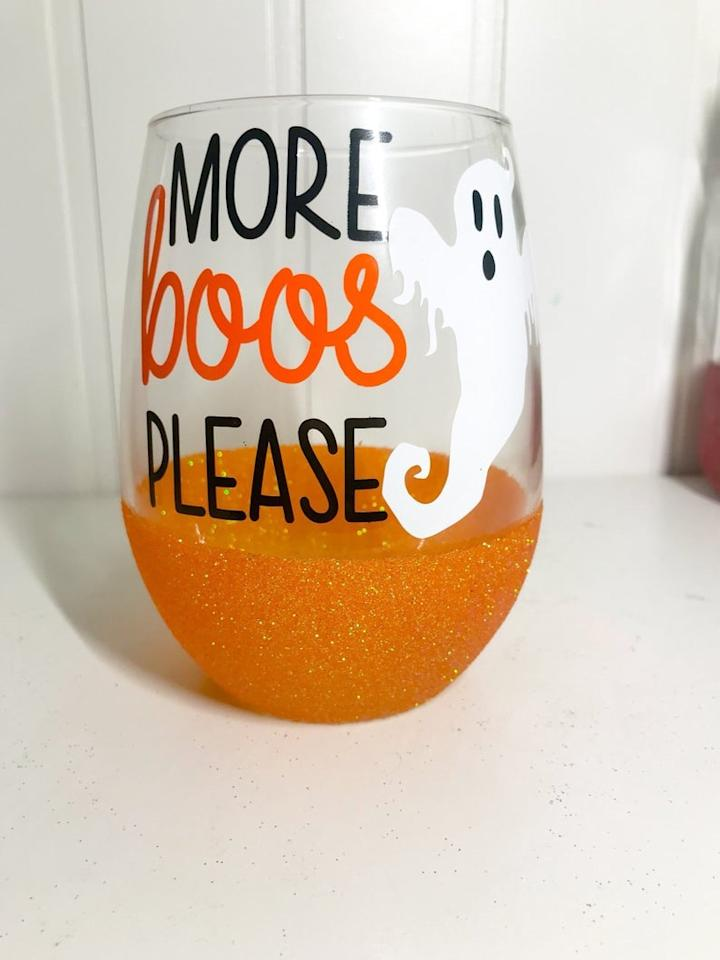 "<p>We love a solid pun almost as much as we love this adorable <a href=""https://www.popsugar.com/buy/More-Boos-Please-Halloween-Wine-Glass-476621?p_name=More%20Boos%20Please%20Halloween%20Wine%20Glass&retailer=etsy.com&pid=476621&price=16&evar1=yum%3Aus&evar9=46466552&evar98=https%3A%2F%2Fwww.popsugar.com%2Fphoto-gallery%2F46466552%2Fimage%2F46466554%2FMore-Boos-Please-Halloween-Wine-Glass&list1=halloween%2Cwine%2Ckitchen%20accessories&prop13=api&pdata=1"" rel=""nofollow"" data-shoppable-link=""1"" target=""_blank"" class=""ga-track"" data-ga-category=""Related"" data-ga-label=""http://www.etsy.com/listing/613146618"" data-ga-action=""In-Line Links"">More Boos Please Halloween Wine Glass</a> ($16). </p>"