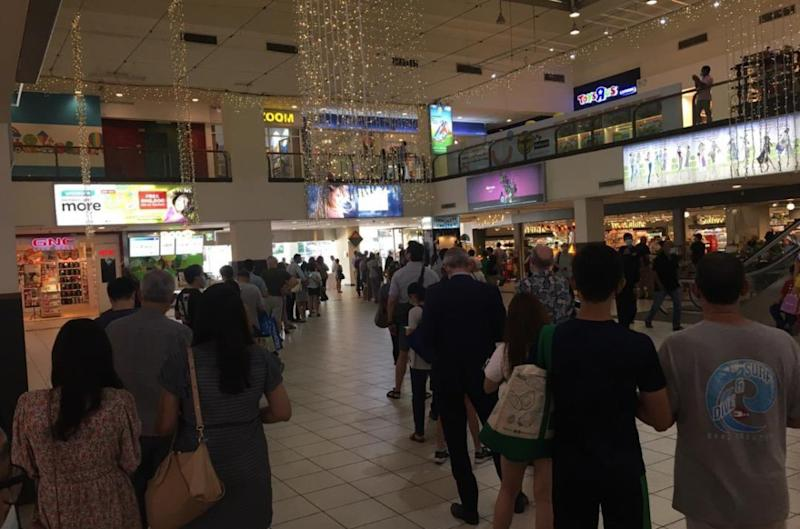 People queuing outside the grocery store at Bangsar Village mall in Kuala Lumpur. Photo: Chicarosa/Twitter