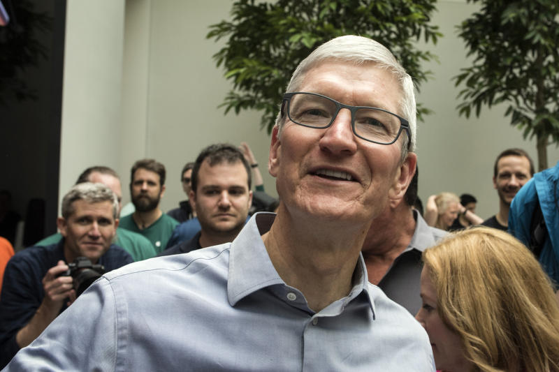 Apple CEO Tim Cook welcomes customers to the company's new store, Apple Carnegie Library, in Washington, Saturday, May 11, 2019. (AP Photo/Cliff Owen)