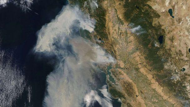 PHOTO: An image acquired by the Moderate Resolution Imaging Spectroradiometer (MODIS) instrument on NASA's Terra satellite shows smoke billowing from the fires in northern California, Oct. 9, 2017. (NASA Earth Observatory/EPA)