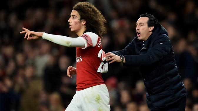 Matteo Guendouzi dan manajer Arsenal, Unai Emery. (AFP/Glyn Kirk)