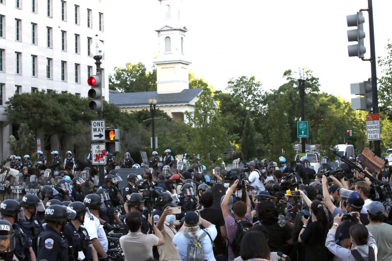 Police clear the area around Lafayette Park and the White House as demonstrators gather to protest the death of George Floyd, Monday, June 1, 2020, in Washington. Floyd died after being restrained by Minneapolis police officers. (AP Photo/Alex Brandon)
