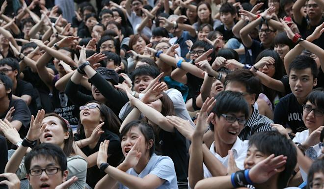 Students, teachers and parents protest against national education measures in 2012. Photo: David Wong