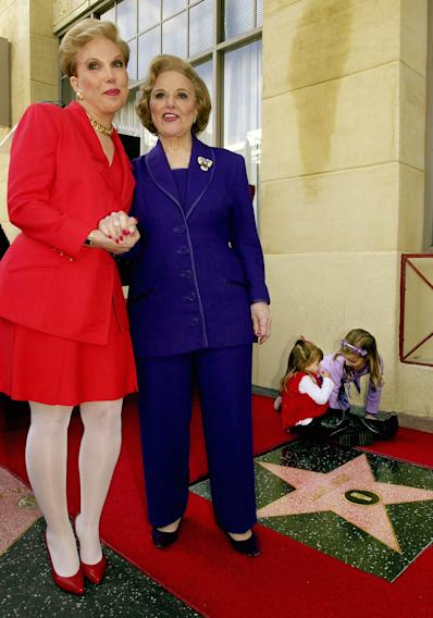 """FILE - In this Feb. 14, 2001 file photo, Pauline Friedman Phillips, right, the nationally-syndicated advice columnist best known as """"Dear Abby,"""" and her daughter Jeanne Phillips, pose after the dedication of a Dear Abby star on the Hollywood Walk of Fame in Los Angeles.  Phillips, who had Alzheimer's disease, died Wednesday, Jan. 16, 2013, she was 94.  Phillips' column competed for decades with the advice column of Ann Landers, written by her twin sister, Esther Friedman Lederer. Their relationship was stormy in their early adult years, but later they regained the close relationship they had growing up in Sioux City, Iowa. The two columns differed in style. Ann Landers responded to questioners with homey, detailed advice. Abby's replies were often flippant one-liners. (AP Photo/Reed Saxon)"""