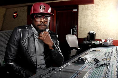 """In this April 24, 2013 photo, will.i.am poses for a portrait in Los Angeles. Will.i.am says he's been unfairly accused of stealing a song from a Russian dance producer. The producer-rapper-singer has acknowledged reaching out to trance producer Arty after hearing his 2011 song with London's Mat Zo, """"Rebound."""" Will.i.am recorded a new version with Chris Brown titled """"Let's Go."""" Will.i.am credits Arty as a writer on the song in the liner notes for his album, """"#willpower,"""" released this week. He blamed the slow legal clearance process his legal team was also at work on the issue. (Photo by Matt Sayles/Invision/AP)"""