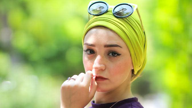ilustrasi perempuan/Photo by ahmed zohnii on Unsplash
