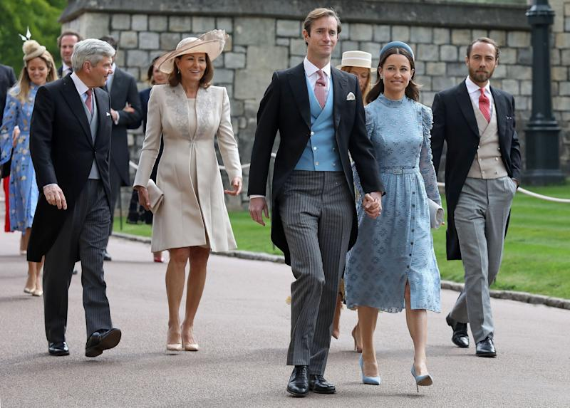 (L-R) Michael and Carole Middleton, James Matthews, Pippa Middleton and James Middleton arrive at St George's Chapel in Windsor Castle, Windsor, west of London, on May 18, 2019, to attend the wedding of Lady Gabriella Windsor to Thomas Kingston. - Lady Gabriella, is the daughter of Prince and Princess Michael of Kent. Prince Michael, is the Queen Elizabeth II's cousin. (Photo by Steve Parsons / POOL / AFP) (Photo credit should read STEVE PARSONS/AFP/Getty Images)