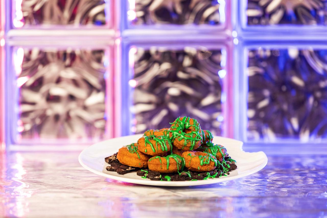 <p>Available at Starcourt Mall in Universal Studios, these mini pumpkin doughnuts are served with warm cookie crumbles and slime-green frosting inspired by the decaying pumpkin patches in Hawkins.</p>