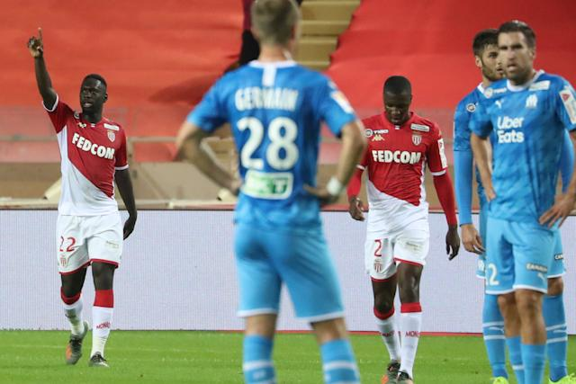 Monaco's French forward Jean-Kevin Augustin (L) celebrates after scoring a goal during the French Ligue Cup round of 32 football match between Monaco and Marseille at the