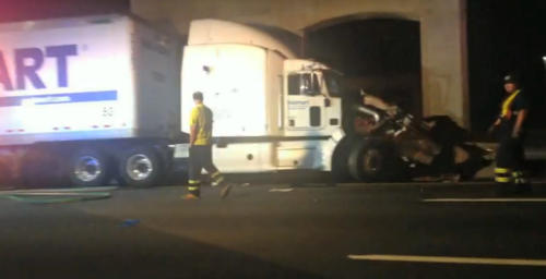 "In this image from video the Wal-Mart truck involved in the crash of the limousine bus carrying Tracy Morgan and six other people is seen early Saturday morning June 7, 2014 on the New Jersey Turnpike at the accident scene. Morgan remained hospitalized as state and federal officials continued their investigation of the six-vehicle crash on the New Jersey Turnpike that took the life of a Morgan friend and left two others seriously injured, authorities say. Wal-Mart President Bill Simon said in a statement a Wal-Mart truck was involved and that the company ""will take full responsibility"" if authorities determine that its truck caused the accident. (AP Photo/Will Vaultz Photography)"