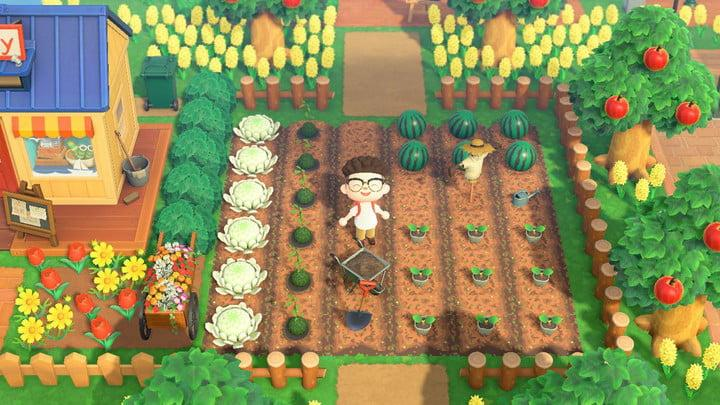 A photo of an Animal Crossing character standing and smiling amidst a custon garden full of vegetables, surrounded by trees and flowers