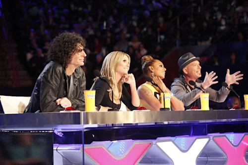 "This March 4, 2013 photo shows the judges for season eight of the talent competition series ""America's Got Talent,"" from left, Howard Stern, Heidi Klum, Mel B, and Howie Mandel during auditions in New Orleans. NBC's ""America's Got Talent"" is moving from New Jersey to New York City's Radio City Music Hall. New York Gov. Andrew Cuomo made the announcement Wednesday, April 3. The eighth season of the popular talent competition will air live from the landmark theater twice a week, starting July 23. (AP Photo/NBC, Skip Bolen)"