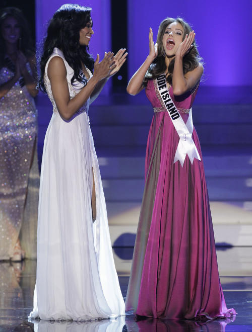 Miss Rhode Island Olivia Culpo reacts after being announced the 2012 Miss USA, as Miss Maryland Nana Meriwether applauds during the Miss USA pageant, Sunday, June 3, 2012, in Las Vegas. (AP Photo/Julie Jacobson)