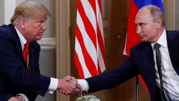 PHOTO: President Donald Trump and Russia's President Vladimir Putin shake hands as they meet in Helsinki, Finland, July 16, 2018. (Kevin Lamarque/Reuters)