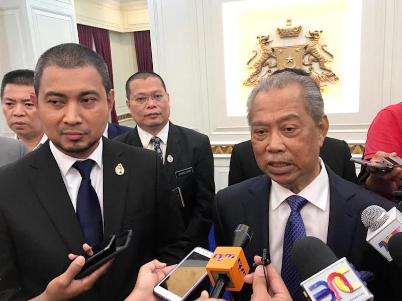 Muhyiddin is pictured with the new Johor Mentri Besar Datuk Dr Sahruddin Jamal. — Picture by Ben Tan