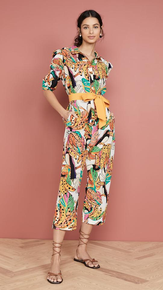 """<p>Go for bold and cheerful in this <a href=""""https://www.popsugar.com/buy/FARM-Rio-Crazy-Tuscanos-Shirt-Jumpsuit-539035?p_name=FARM%20Rio%20Crazy%20Tuscanos%20Shirt%20Jumpsuit&retailer=shopbop.com&pid=539035&price=255&evar1=fab%3Aus&evar9=45860055&evar98=https%3A%2F%2Fwww.popsugar.com%2Fphoto-gallery%2F45860055%2Fimage%2F47093383%2FFARM-Rio-Crazy-Tuscanos-Shirt-Jumpsuit&list1=shopping%2Cjumpsuits%2Cspring%20fashion%2Cwinter%20fashion&prop13=api&pdata=1"""" rel=""""nofollow"""" data-shoppable-link=""""1"""" target=""""_blank"""" class=""""ga-track"""" data-ga-category=""""Related"""" data-ga-label=""""https://www.shopbop.com/crazy-tuscanos-shirt-jumpsuit-farm/vp/v=1/1579168774.htm?folderID=13267&amp;fm=other-shopbysize-viewall&amp;os=false&amp;colorId=19784&amp;ref=SB_PLP_NB_48"""" data-ga-action=""""In-Line Links"""">FARM Rio Crazy Tuscanos Shirt Jumpsuit </a> ($255).</p>"""