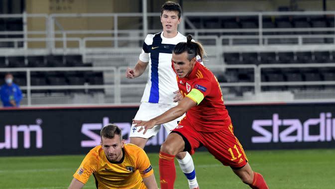 Gareth Bale saat memperkuat Timnas Wales di laga kontra Finlandia pada ajang Nations League, Jumat (4/9/2020) dini hari WIB. (Markku Ulander / LEHTIKUVA / AFP)