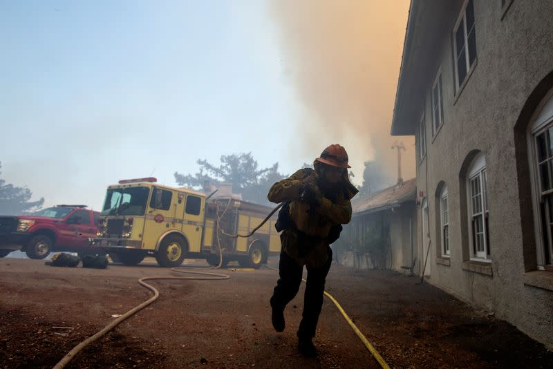 California firefighters race to subdue flames before heat and winds return
