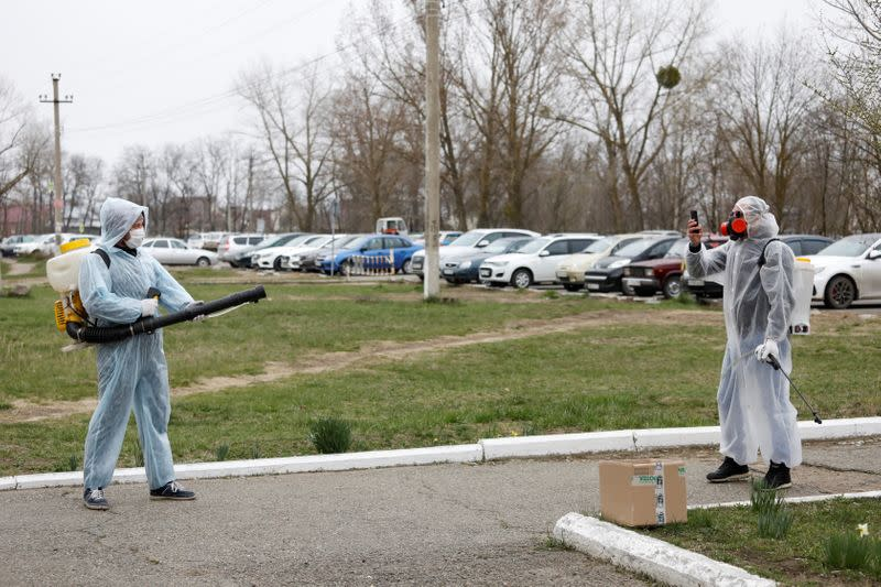 Specialists sanitize a hospital to prevent the spread of the coronavirus disease in Mikhaylovsk