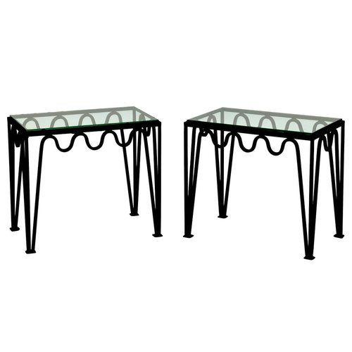 """<p><strong>Blend Interiors </strong></p><p>blendinteriors.com</p><p><strong>$4200.00</strong></p><p><a href=""""https://www.blendinteriors.com/designfreres/tables/the-mandre-blackened-steel-and-glass-side-table-2bhf4"""" target=""""_blank"""">Discover</a></p><p>Designed in the style of Jean Royère, these blackened steel and glass-topped side tables feature a wave-like base that makes them decidedly chic. </p>"""