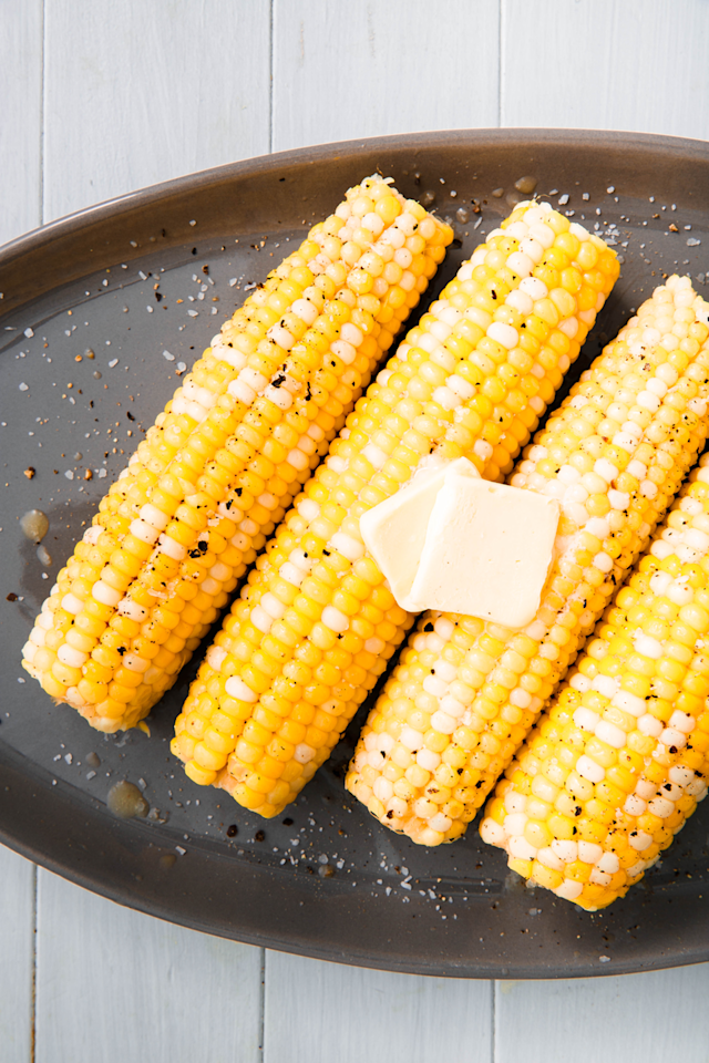 """<p>First thing's first: Here's the most basic way to prep corn.</p><p>Get the recipe from <a href=""""https://www.delish.com/cooking/a22487458/corn-on-the-cob/"""" target=""""_blank"""">Delish</a>.</p>"""