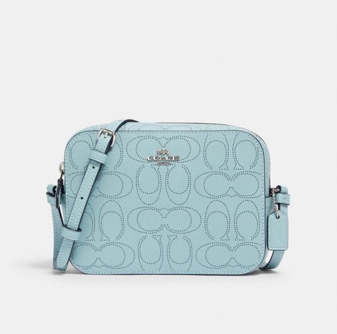 Mini Camera Bag In Signature Leather. Image via Coach Outlet.