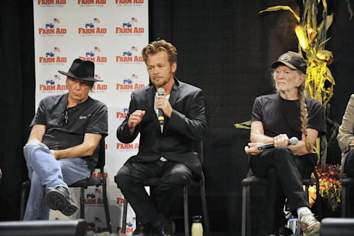 Neil Young, left, John Mellencamp, center, and Willie Nelson, right, talk with reporters during a news conference prior to the start of the Farm Aid 2013 concert at Saratoga Performing Arts Center in Saratoga Springs, N.Y., Saturday, Sept. 21, 2013. (AP Photo/Hans Pennink)