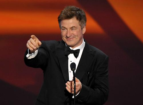 FILE - This Jan. 27, 2013 file photo shows actor Alec Baldwin presenting the Screen Actors Guild Life Achievement Award to Dick Van Dyke at the 19th Annual Screen Actors Guild Awards at the Shrine Auditorium in Los Angeles. Baldwin has donated $2,500 to help the chess team at Central Falls High School in Rhode Island defray the cost of traveling to a national tournament next month. The city of Central Falls has made national news because of financial problems, and the news coverage previously caught Baldwin's attention. Baldwin also contributed $10,000 two years ago to the Central Falls library to help it reopen after it was forced to close because of money problems. The city emerged from bankruptcy last year. (Photo by John Shearer/Invision/AP)