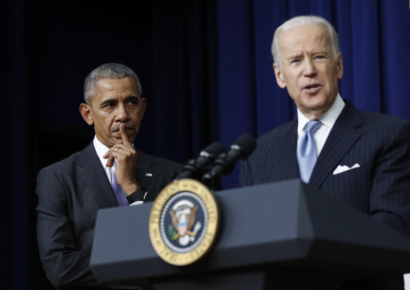 "FILE - In this Dec. 13, 2016, file photo, President Barack Obama listens as Vice President Joe Biden speaks in the South Court Auditorium in the Eisenhower Executive Office Building on the White House complex in Washington. Biden is getting some help from Obama as he looks to fill his campaign coffers and unify the Democratic party ahead of the November election. Obama and Biden will appear together Tuesday, June 23, for a ""virtual grassroots fundraiser,"" the former vice president announced on Twitter. (AP Photo/Carolyn Kaster, File)"