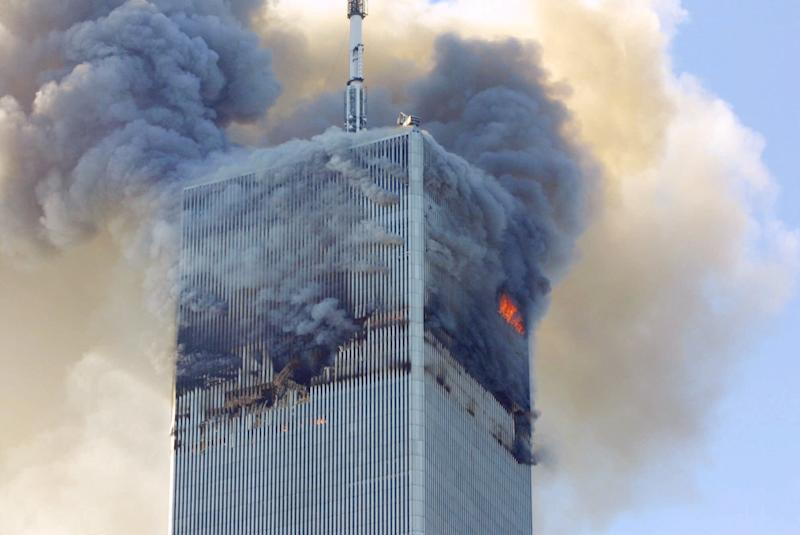 Fire and smoke billows from the north tower of New York's World Trade Center after terrorists crashed two hijacked airliners into the World Trade Center and brought down the twin 110-story towers.