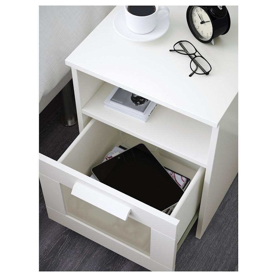"""<p>With a shelf for books and a drawer for extra essentials, you can't go wrong with the <product href=""""https://www.ikea.com/us/en/p/brimnes-nightstand-white-10234942/"""" target=""""_blank"""" class=""""ga-track"""" data-ga-category=""""Related"""" data-ga-label=""""https://www.ikea.com/us/en/p/brimnes-nightstand-white-10234942/"""" data-ga-action=""""In-Line Links"""">Brimnes Nightstand</product> ($40).</p>"""