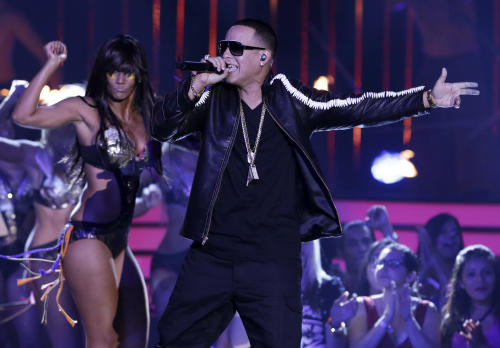 FILE - This April 25, 2013 file photo shows singer Daddy Yankees performing at the Latin Billboard Awards in Coral Gables, Fla. Zumba Fitness instructors worldwide are not only using the Latin-heavy song lineup in their classes but creating new fans for artists such as Pitbull, Daddy Yankee and Don Omar, all of whom have recorded songs for Zumba. (AP Photo/Alan Diaz, File)
