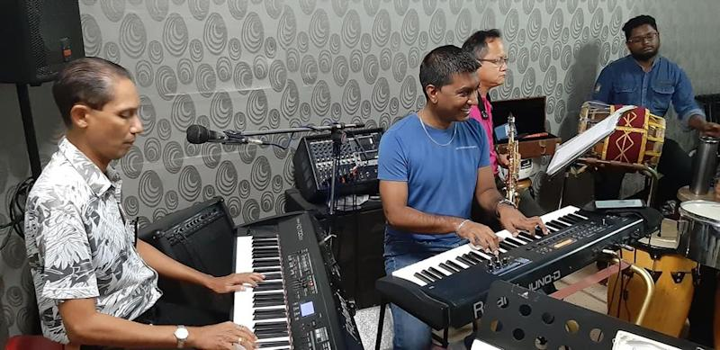 Sanjiv (middle) rocking out with his friends at the Music Mart music school. — Picture courtesy of Aseana Percussion Unit