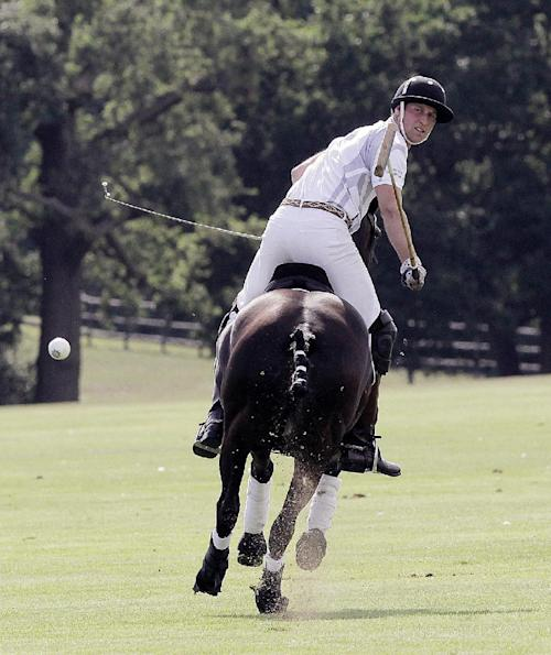 The Duke of Cambridge, Britain's Prince William plays in the Audi Polo Challenge charity polo match, at Coworth Park, near Ascot, England, Saturday Aug. 3, 2013. Prince William has made his first public appearance since leaving hospital with his newborn son, playing in a charity polo match alongside brother Prince Harry. (AP Photo / Jane Mingay)
