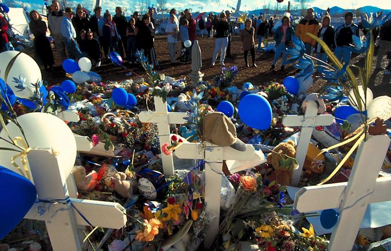 Flowers at a makeshift memorial for the 13 Columbine High School massacre victims in 1999. Source: Getty