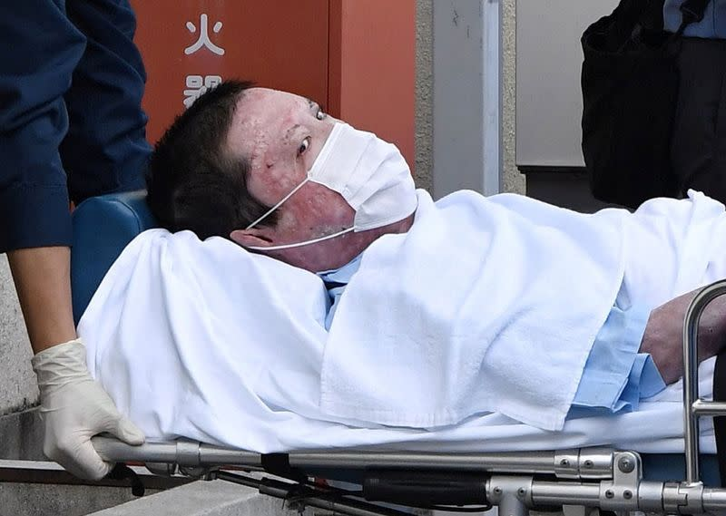 Shinji Aoba, a suspected arsonist who is suspected of killing 36 people at Kyoto Animation in July 2019, is seen on a stretcher as he is carried to Fushimi police station after being arrested in Kyoto, Japan